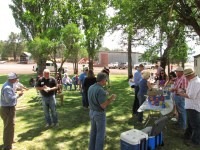 Gold Dust and Walker Brothers' guests enjoy sandwiches on the lawn at the Running Y Ranch headquarters.