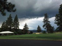 Black clouds in the distance at the Running Y Ranch golf course.