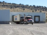 A semi-truck with a refrigerated trailer waits to be filled at Gold Dust Potato Processors' packing shed.