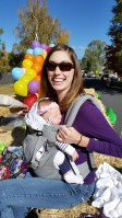 Katie Walker holds her daughter, Madison, at the 77th Annual Klamath Basin Potato Festival.