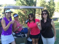 Lexi Crawford, Brenda Walker, Destiney Huffman and Kathy Poppe enjoy a shot of Fireball on the Make-A-Wish hole during the 2015 Open House Field Day Golf Scramble.