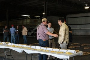 Weston Walker talking to guests from Nong Shim during the 2015 Open House Field Day.