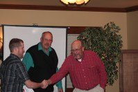 Bill and John Walker congratulate Matt Thompson for his hard work as the packing shed manager at the 2015 Leadership Dinner.