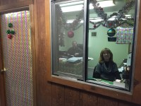 Rich Wright and Jeanne Plante look from the window of the office they decorated for Gold Dust's Christmas Office Decorating Contest.