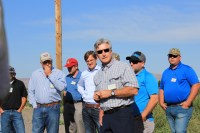 Paul Sproule discusses the merits of Lamoka potatoes to Gold Dust Potatoes' guests at potato field near Tulelake, CA.