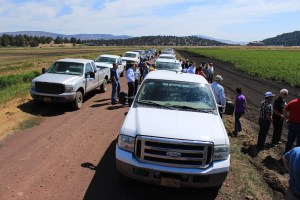 A collection of cars and pickups at the Running Y Ranch to see an organic potato field operated by Walker Brothers farm.