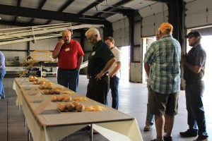 Bill Walker and Alan Collette looking at chipping potato samples at Gold Dust's potato processing plant near Malin, OR.