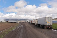 Trucks with refrigerated vans lare lined up at Gold Dust Potato Processors' Malin, Oregon potato packing shed.
