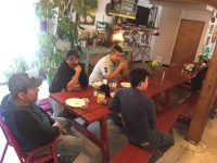 Four of Gold Dust Potato Processors' shed crew members eating pizza at Bigoni's Pizza Barn in Malin, Oregon.