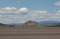 A chipping potato field being planted near Worden, Oregon with the Cascade Mountain range in the distance.