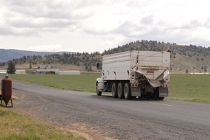 A Walker Farms potato truck headed to a field with chipping potato seed near Malin, OR.