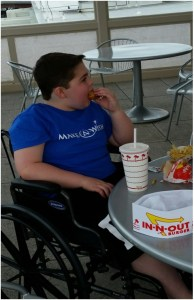 Krue Johnston enjoying an In-N-Out hamburger at the Medford Regional Airport.