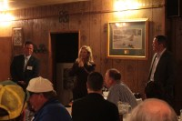 Klamath County Commissioners Donnie Boyd, Kelly Minty-Morris and Derrick DeGroot answering questions at Mike & Wanda's Restaurant during Gold Dust and Walker Farms' 17th annual Open House Field Day.