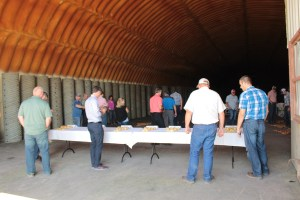 Guests for Gold Dust and Walker Farms' Open House Field Day inspecting chipping potato samples in Cellar 1 on Gold Dust's Malin campus.