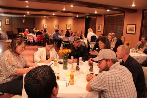 Gold Dust and Walker Farms employees discussing ways to make the businesses better at the annual Leadership Dinner.