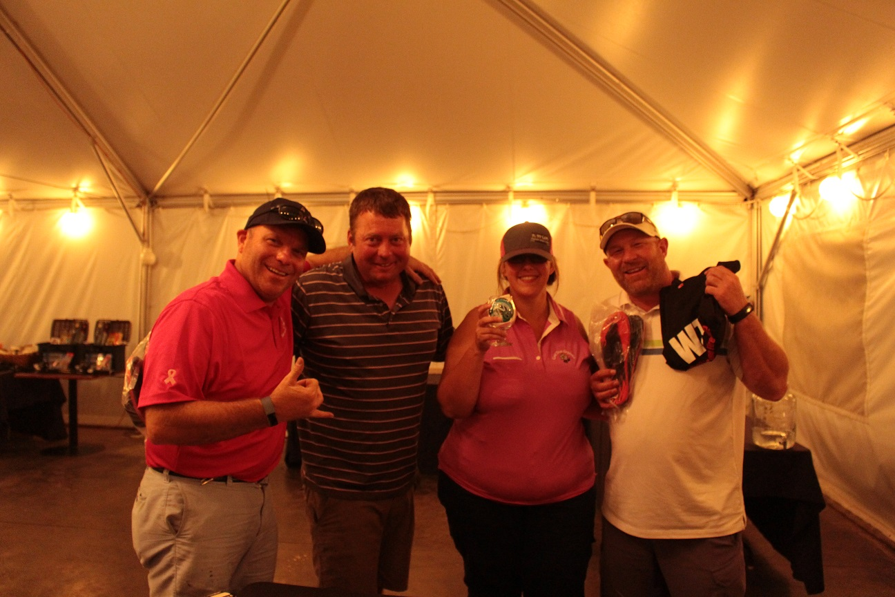 Jeff Gibson, Luke Robison, Tricia Hill & Ken Hibbard showing off Last Place prizes