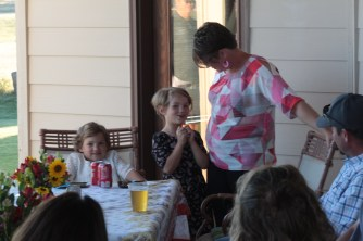 Eleanor and Michelle Pine telling Gold Dust & Walker Farms' guests about Make-A-Wish