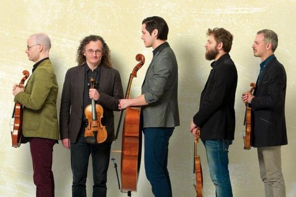 Violin player Colin Jacobsen (far right) with Brooklyn Rider and Irish fiddler Martin Hayes (second from left)