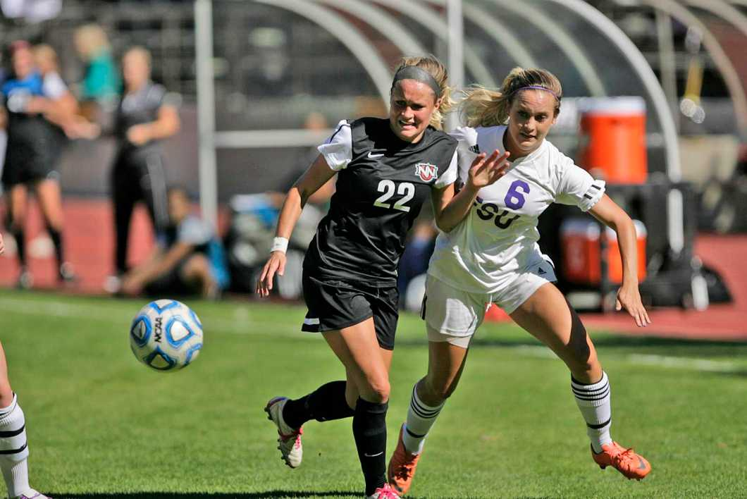 Autumn Fox, right, tries to gain control of the ball from Katie Butler during a game featuring the SF State Gators vs the Northwest Nazarene University Crusaders at Cox Stadium on Sept. 5. The Gators were able to secure a victory one minute into the first overtime, with the final score being 1-0. Photo by John Ornelas / Xpress