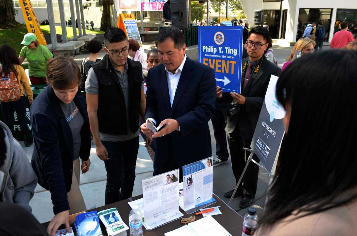 Ariel Boone and assembly member of district 19, Philip Y. Ting help explain the Affordable Care Act to SF State students at Cesar Chavez Plaza during an event Thursday, Oct. 10, 2013 in the afternoon. Photo by Amanda Peterson / Xpress