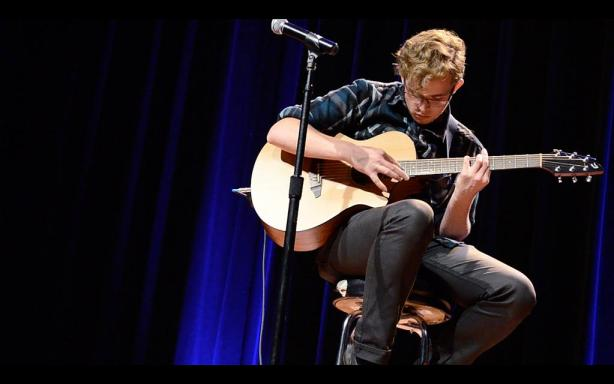 Sean Thompson plays guitar during The Voice competition at SF State, Oct. 23, 2013. Photo by Shawn Whelchel / Xpress