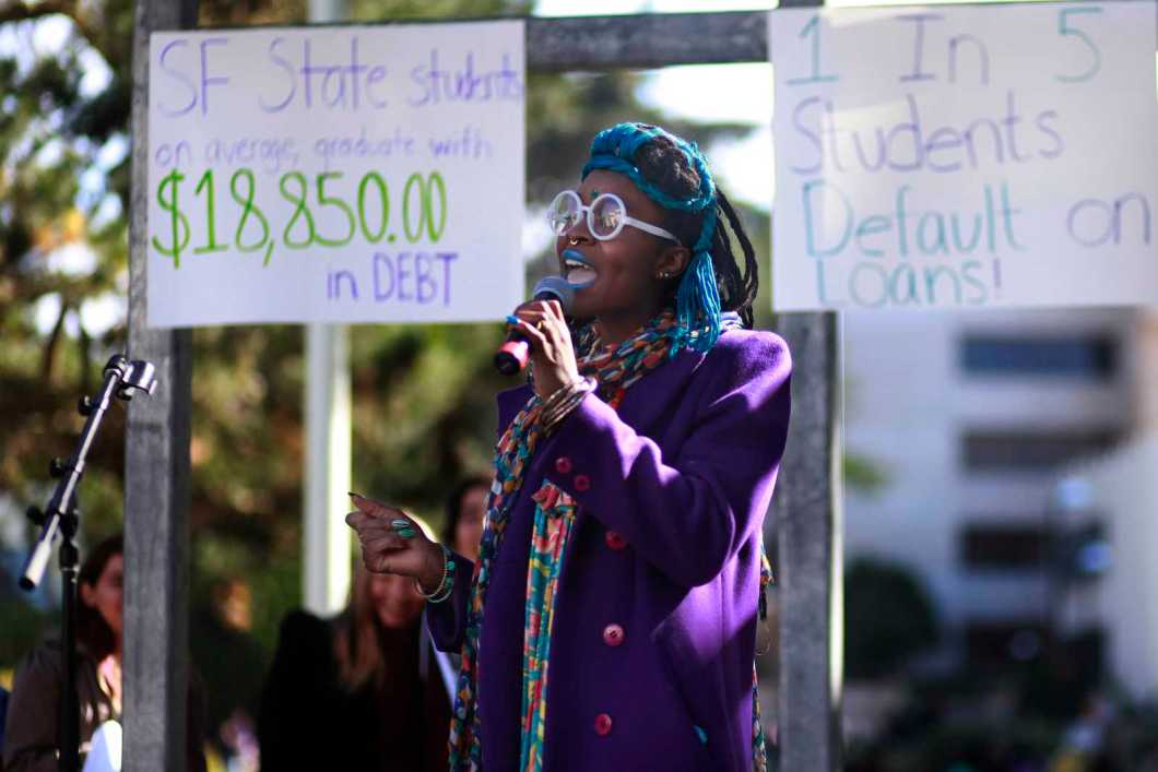 Telisa Nyoka, a recent ethnic studies graduate and TA, sings during the equity week rally at SF State in Malcolm X Plaza, Oct. 28, 2013. Her song related to the high cost of tuition and student debt. Photo by Mike Hendrickson / Xpress