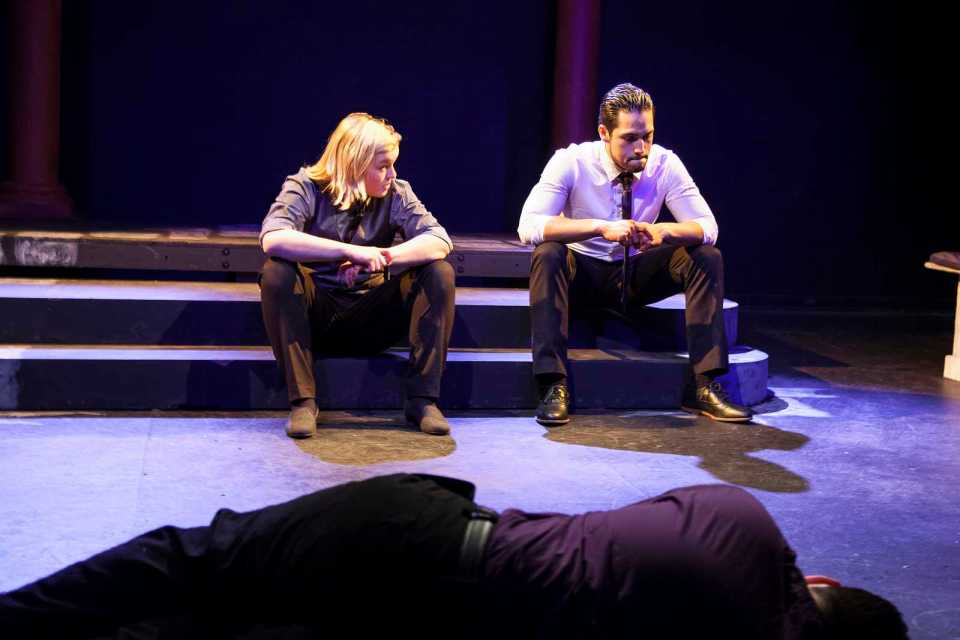 Theater majors Lo Prentiss as Cassius and Jonathan Schulz as Brutus in a scene from this semester's Brown Bag Theatre's abbreviated version of Julius Cesar. Kyle McReddie, lying on the floor, plays the dead Julius Cesar. Photo by Ayesha Rizvi / Xpress
