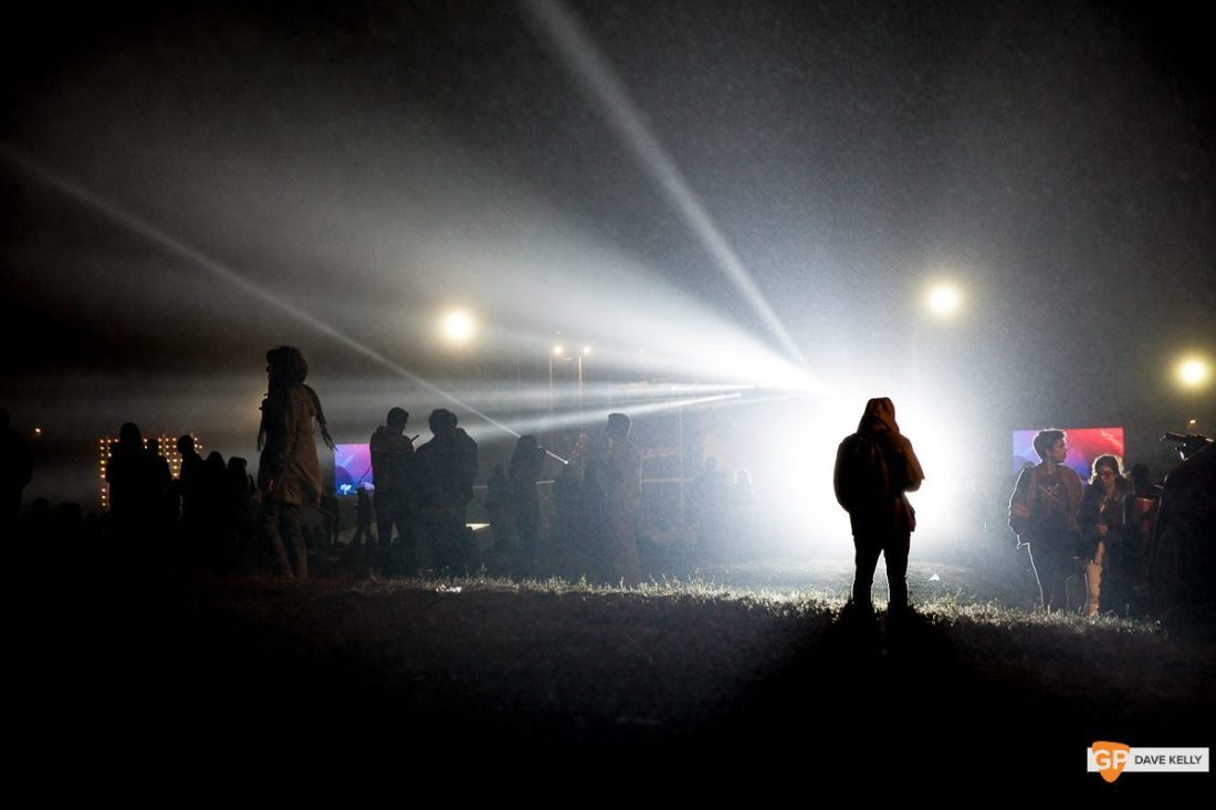 A lone figure silhouetted by the lights of the main stage at NOS Primavera Sound, Porto by David Kelly