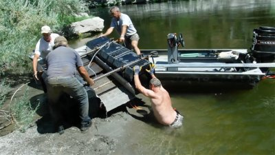 Loading sluice into boat