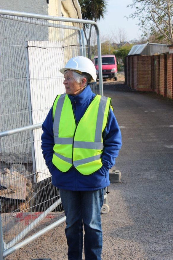 Barbara in full safety gear with hi-viz jacket and hard hat