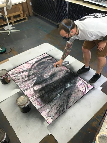 Snik stencilling a collaboration canvas with Martin Whatson