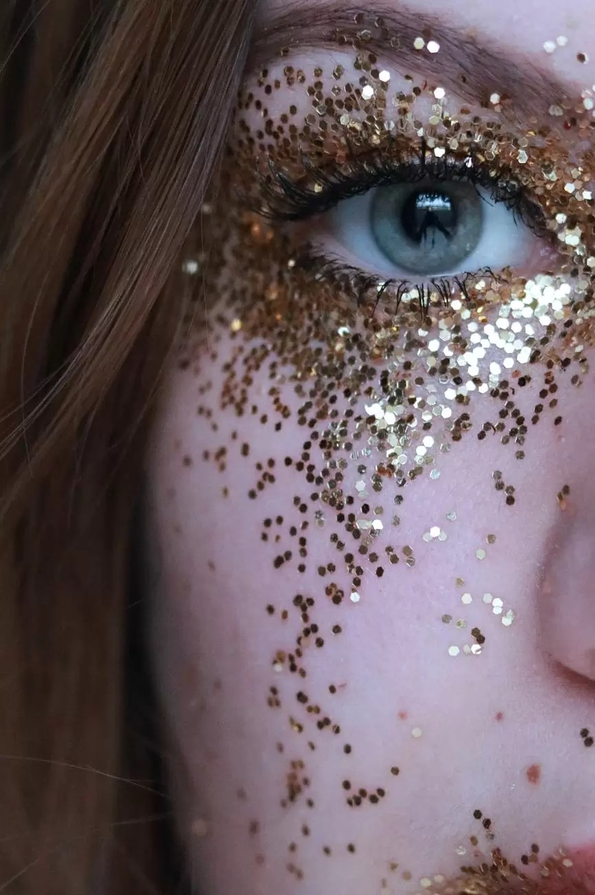 close up photo of woman with gold glitters on her face
