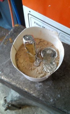 With the plaster at the end of a tubular mould, pour the lead