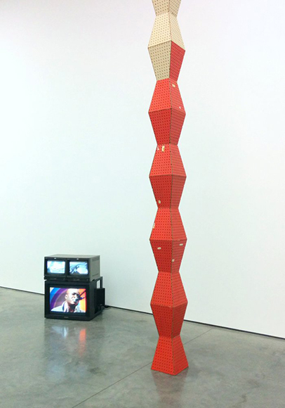 Brancusi style column made from pegboard and video