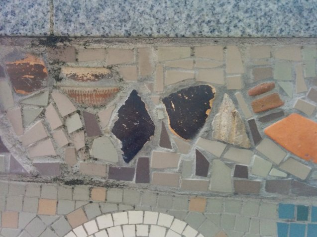 Detail of Queenhithe mosaic: mudlarked objects embedded into the mosaic