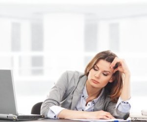 Business woman working in office desk job