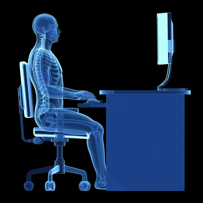 x-ray of employee at workstation