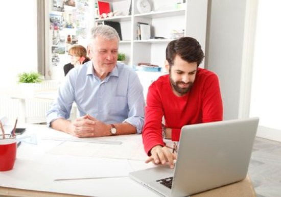 Teamwork in small architect studio small business