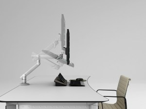 office desk with monitor arm holding screen