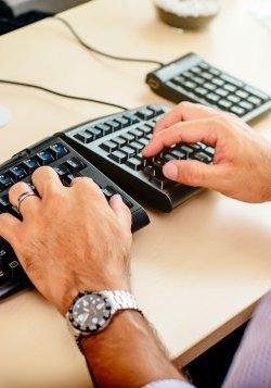 employee using split keyboard