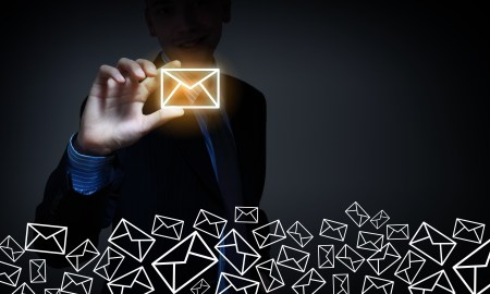 man holding email icon