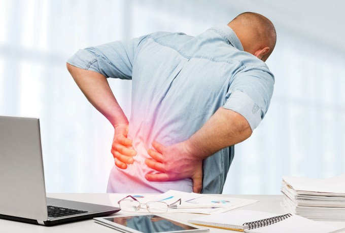Back pain hitting employee while at office