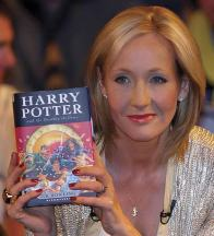 JK Rowling holding Harry Potter Book