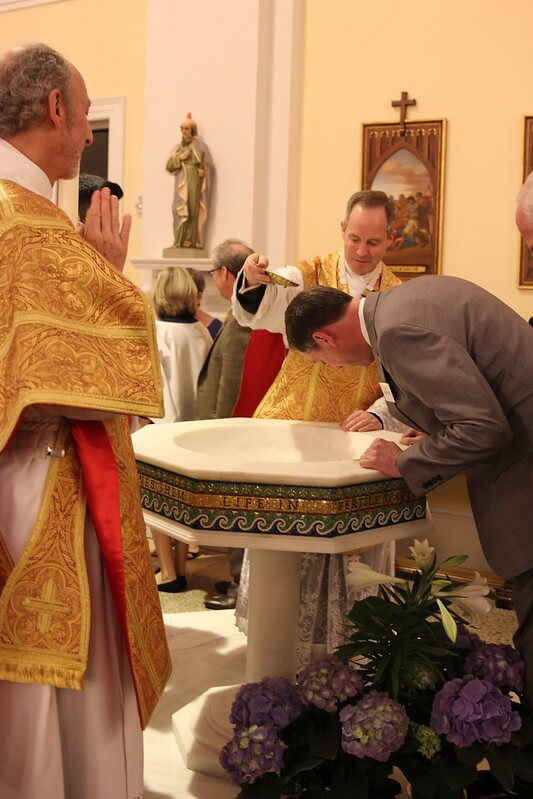 Adult baptism. Photo credit: SueAnn Howell, Catholic News Herald