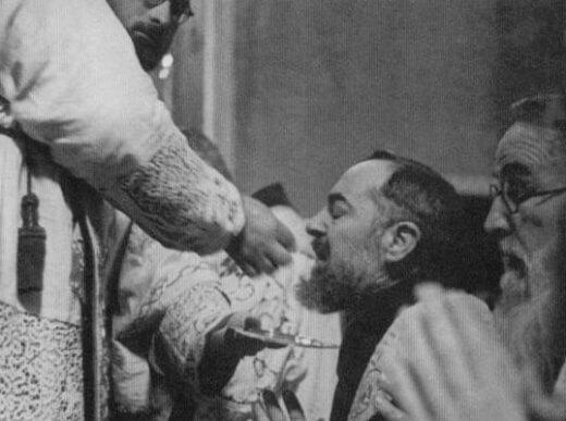Padre Pio receiving Holy Communion