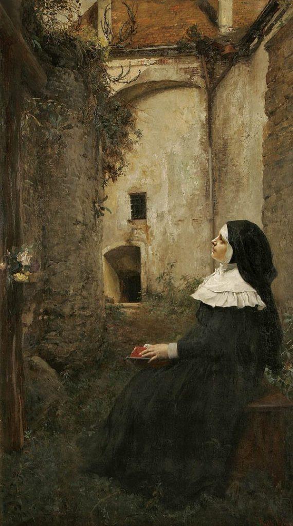 A nun listening in an inner courtyard