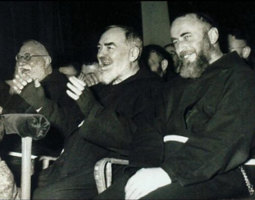 Padre Pio enjoying a show with his brothers