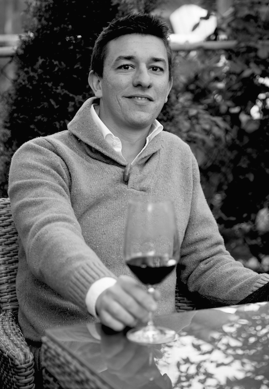 You'll rarely see Nicholas Pearce without a glass of wine in his hand.