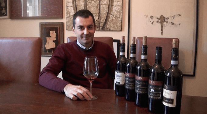 Tommaso Cortonesi from the Montalcino based winery La Mannella explains his wines while a small Pomeranian with a squeaky toy runs around his feet.