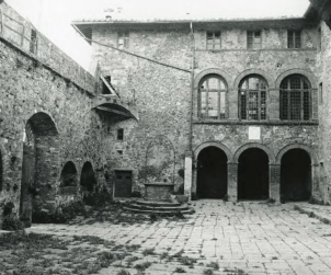 The courtyard with battlements, well and a loggia before Charlotte's restoration.